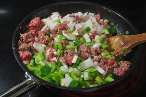 Add the veggies when the meat is almost browned