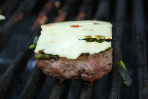 Cover with chilies and then top with cheese