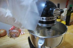 The wax paper makes pouring the flour into the mixer easy.