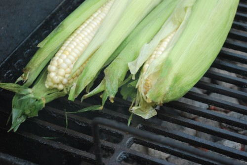I place the corn directly over the coals