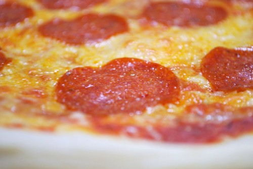 The cheese is golden and the pepperoni are glistening.  The perfect pie!!!