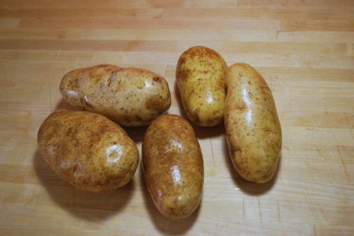 Gently scrub the potatoes as we are leaving the skins on.