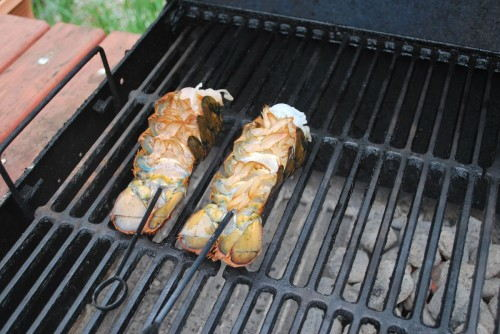 Place right on the edge of the hot and cold zones of the grill.