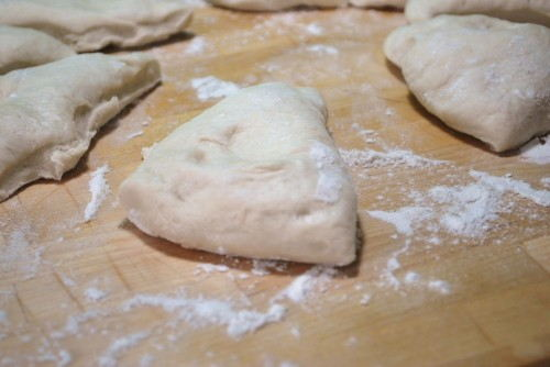 I find it is easiest to cut the dough into 8 pie shaped pieces.