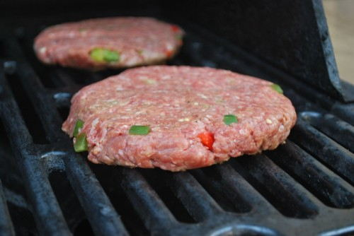 Place the meat on preheated grates