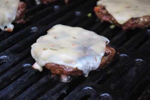 Closing the lid of the grill helps the cheese melt.