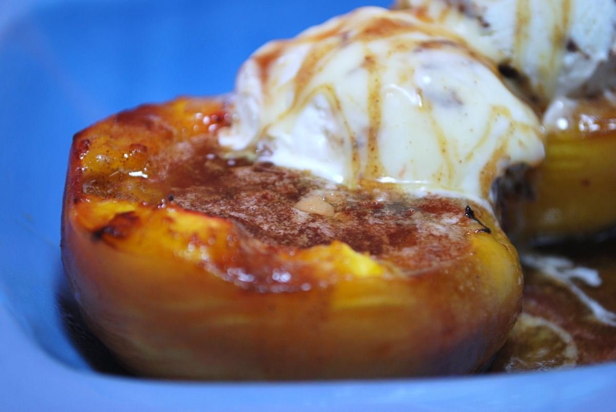 Grilled peaches topped with ice cream