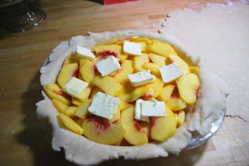 Add the peaches and dot with butter