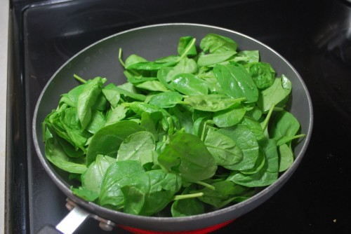 The greens will be overflowing for about 10 seconds, but they cook down quick.