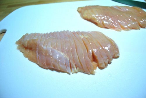 Slice the chicken into 1/4 inch strips