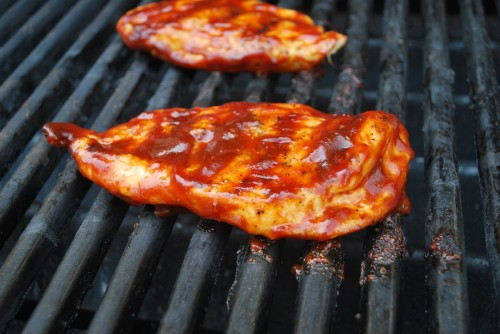 Coating, flipping and grilling will secure the sauce to the chicken