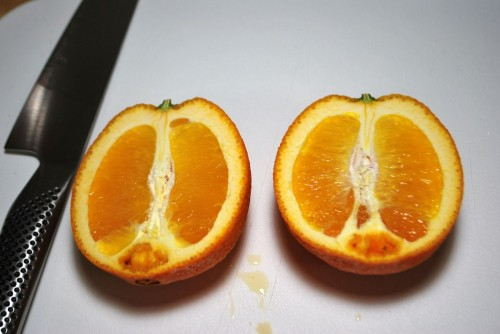 I used navel oranges as that is all that I could find this time of year.  Make sure cut them lengthwise through the stem.
