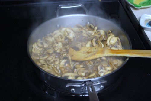 Add the broth and let it reduce