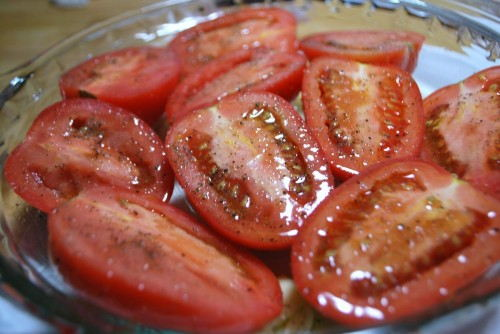 Tomatoes ready to roast, arrange cut side up.