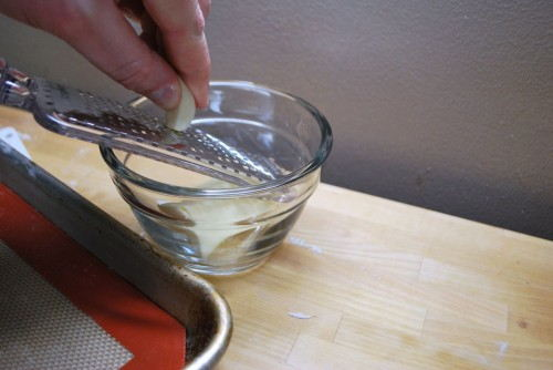 Grating the garlic is the simplest way to finely shred the garlic clove