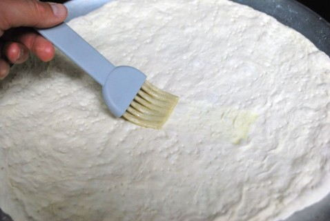 Brush the dough with butter
