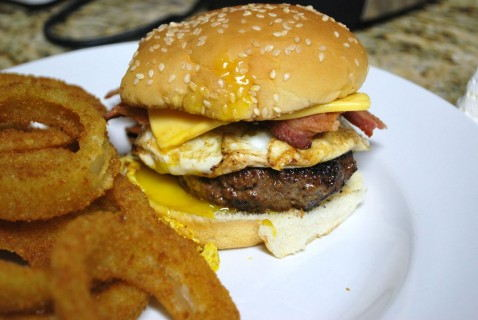 Bacon egg and cheeseburger with onion rings