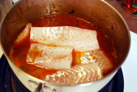 Gently place the fish into the stew