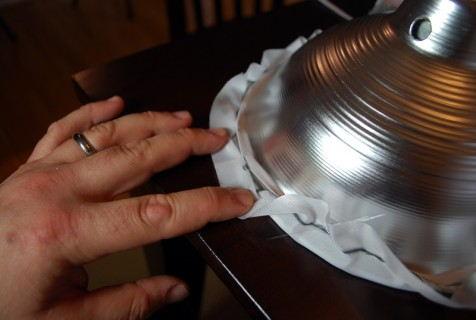 Stretch the fabric around the cone