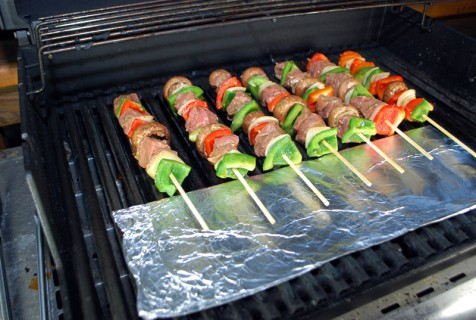 Use foil as a grill shield