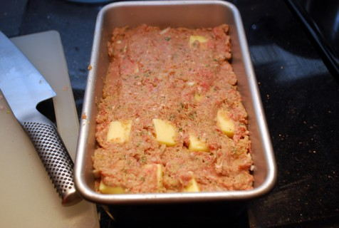 Layer the cheese and meatloaf mixture