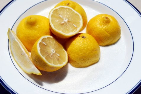 Cut the lemons in half