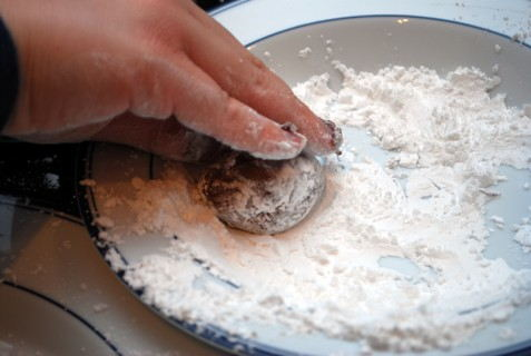 Roll in confectioners' sugar