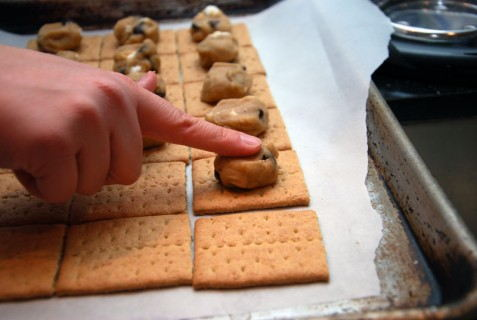 Line up the graham crackers and top with 1 tbs of the dough