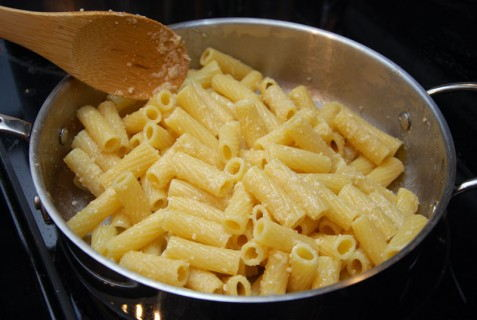 Butter the pasta and toss with cheese