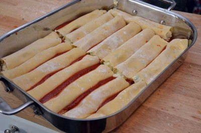 Place the manicotti into a baking dish