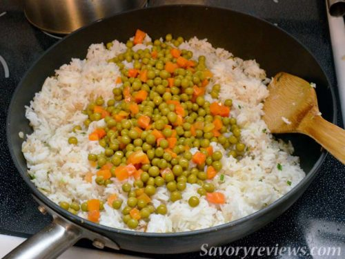 Add the peas and carrots